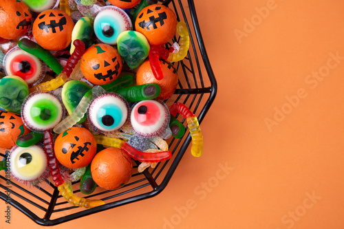 Funny Haloween candy in a spiderweb bowl