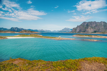 Wall Mural - Bright beautiful landscape, Lofoten islands in Norway, blue sky and turquoise water, summer sunny day