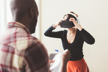 young adult woman looking film with 3D viewer – technology, simulation, interaction