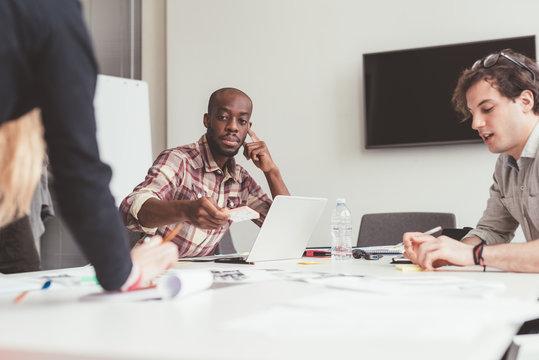 Three millennials multiethnic business people meeting