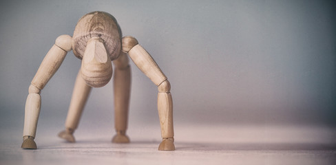 Brown 3d figurine exercising on floor