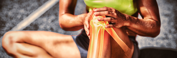 Low section of sportswoman suffering from knee pain