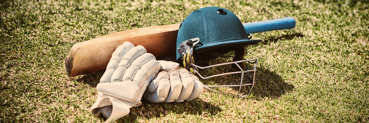 High angle view of cricket equipment on field