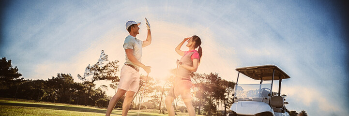 Wall Murals Golf Full length of golf player couple giving high five