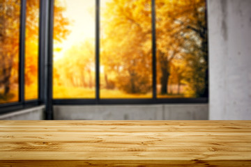 Wooden desk of free space and autumn window background