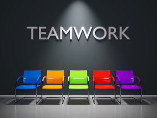 Teamwork text on dark waitingroom with five colored chairs