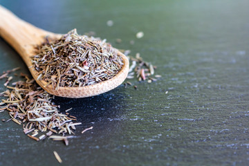 Spoon with dried thyme