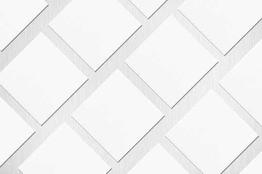 Many empty white square business card mockups with soft shadows lying diagonally on neutral light grey textured background. Flat lay, top view. Open composition.