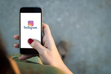 Woman walking smartphone instagram