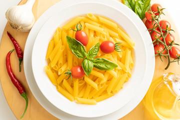 Dish with macaroni tomato and basil