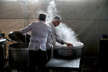 Iranian men cook food during a ceremony marking Ashura in Tehran