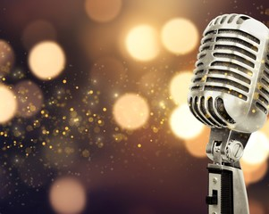 Retro style microphone on blurred background