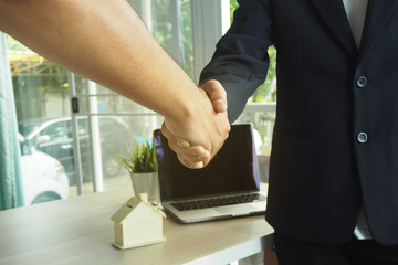 Both businessmen handshake. They agree with the contract. Contract Signing and contract for Sale and Purchase concept.