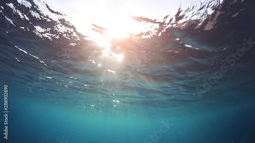 Wall mural Sun rays and waves of the red sea