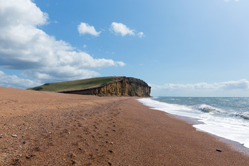 Wall Mural - Freshwater Bay Dorset with beach waves and sandstone cliffs
