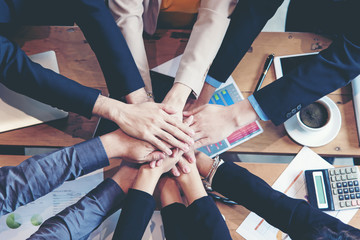 Teamwork Success.  Top view executive business people group team happy showing teamwork and joining hands after meeting partner business in office. Business  Concept.