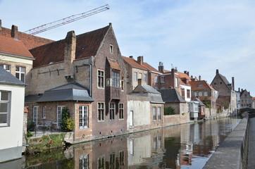 Wall Murals Bridges Bruges, Belgium. Image with Rozenhoedkaai in Brugge, Dijver river canal twilight and Belfort (Belfry) tower.