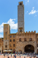 Tourists at the piazza duomo in San Gimignano, Italy
