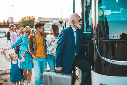 Group people boarding on travel bus.  Traveling, tourism and vacation concept.