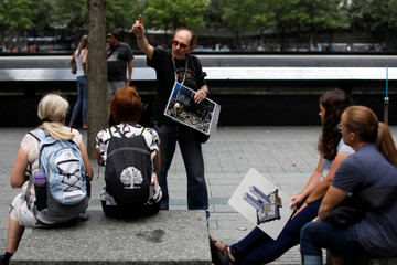 Man describes September 11, 2001 attacks to tourists at the 911 Memorial and Museum in New York