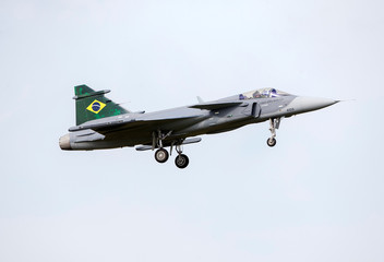 Handing over the first Saab Gripen E fighter to Brazil, in Linkoping