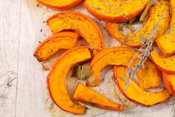 Fotobehang - pumpkin slices with herbs and spices