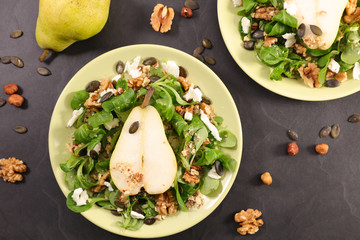 Fotobehang - vegetable salad with cheese, walnut and pear- autumnal salad