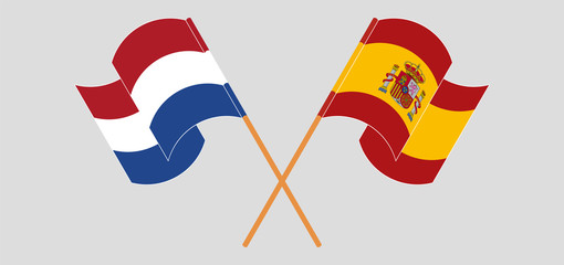 Crossed and waving flags of Netherlands and Spain