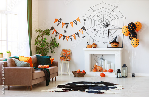 interior of house decorated for Halloween pumpkins, webs and spiders.