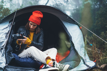 Wall Mural - photographer tourist traveler take photo on camera in camp tent in foggy rain forest, hiker woman shooting mist nature trip tourism, rest vacation concept camping holiday