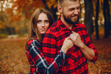 Couple in a park. Family in a golden forest. Man with a beard