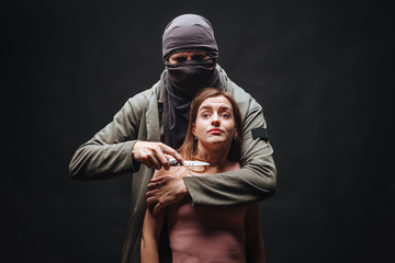 Masked man threatening girl with knife