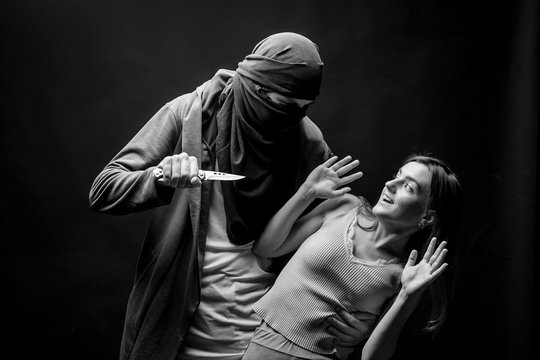 man wants to stab a girl with a knife. black-white