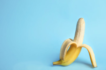 Fresh banana on light blue background, space for text. Sex concept
