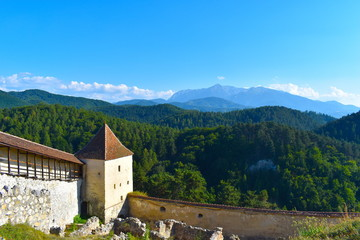 Poster de jardin Europe de l Est Panoramic landscape featuring historic Romanian fortress and its stone walls in the mountains of Transylvania. Boiana Brasov, Romania, the Balkans, Eastern Europe