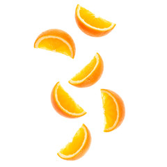 falling fresh orange fruit slices isolated on white background closeup. Flying food concept. Top view. Flat lay. Orange slice in air, without shadow.