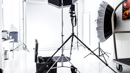 Beautiful shot of a photography studio with white lights and background