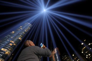 Albert Liguori, 50 from Staten Island, photographs under the Tribute in Light, lit to commemorate the 18th anniversary of September 11, 2001 attacks in New York City