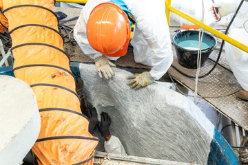 Lining coating repair by fiber glass resin people working in confined space