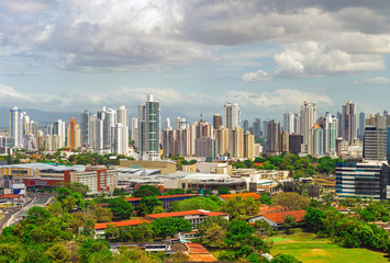 Fotomurales - The urban skyline of Panama City with its impressive skyscrapers at sunrise, Panama.
