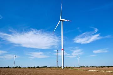 Wind energy generaton in a barren field seen in Germany