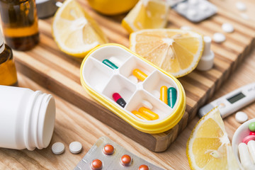 Yellow capsule container box with pills for daily take medicine