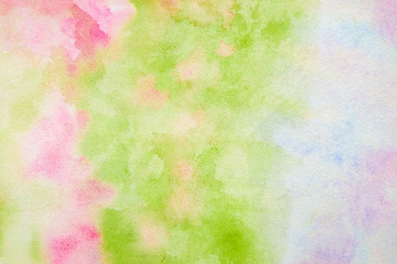 Abstract pink-green watercolor background, bright, contrast splashes, drops, smudges. Artistic background with paper texture.