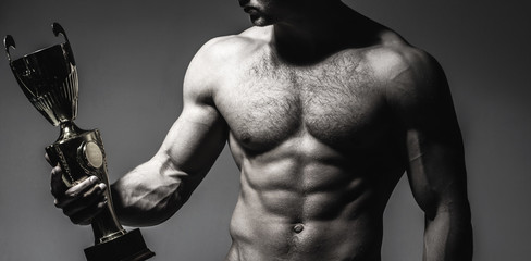Sport man, abs, bodybuilding, fitness, ab. Champion cup, man is holding gold cup. Muscular man, male naked, win muscular guy, torso man. Winner strong man, sport, professional champion.
