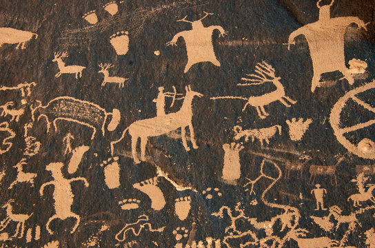 Hunting petroglyph on patinated cliff face, Bears Ears National Monument, Utah