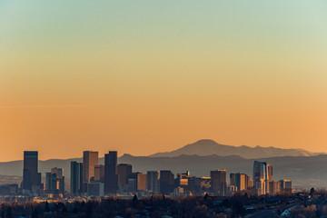 Denver skyline against a background of mountains