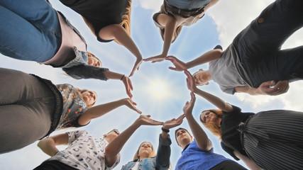 Conceptual symbol of cooperation diverse hands making a circle.