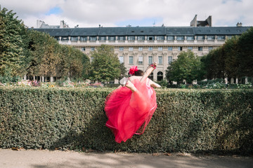 Princess in pink dress falls in the bushes
