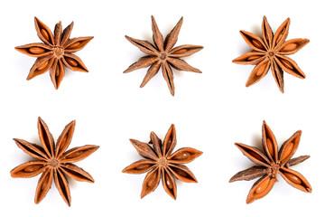 Star anise. Set of six star anise fruits. Closeup Isolated on white background with shadow, top view of chinese badiane spice or Illicium verum.