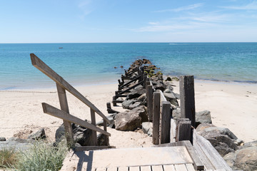 breakwater and wooden path access in sand dune beach in Vendee Noirmoutier Island France Wall mural